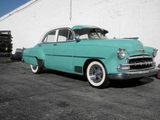 1951 Chevy Deluxe, seafoam green with white and seafoam green leather interior. Brand new custom paint job.