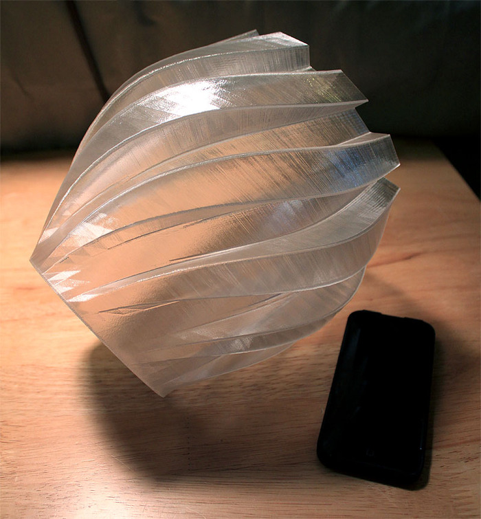 Large t-glase Twisted Gear Vase printed on Helix Beta (next to iPhone for scale)