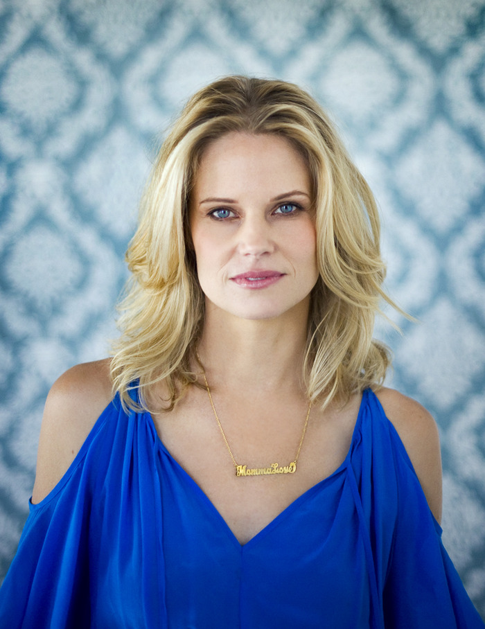 Joelle Carter showing her Momma Love