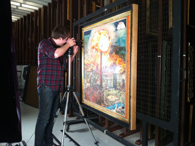 "Producer Nick Young re-photographing the painting ""This is the Nemesis"""