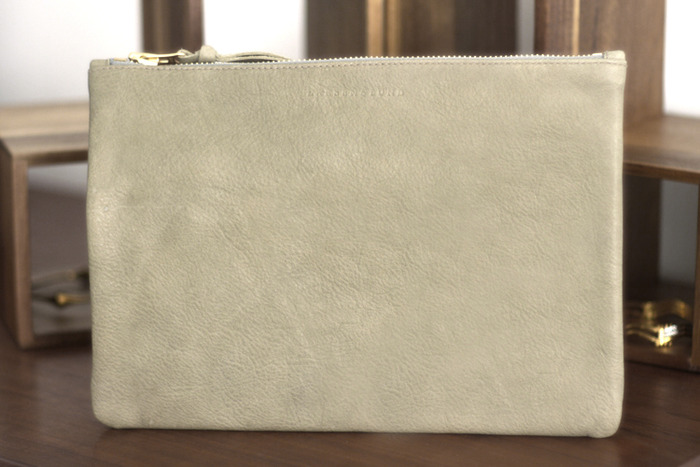 """FULL-SIZE CLUTCH in sage green. 11"""" wide x 8"""" high."""