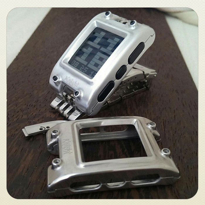 This photo shows two Knight Prototypes. The aluminum Knight on the Pebble and the stainless steel in the front of the image.