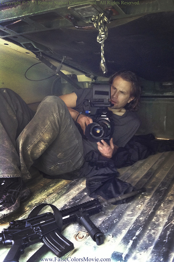 William Norton frames up a shot from the back of a Humvee for a scene in False Colors.