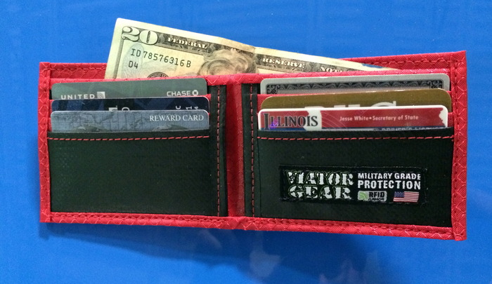 6 horizontal pockets, 2 vertical pockets and cash slot - Color: Fire (Red)
