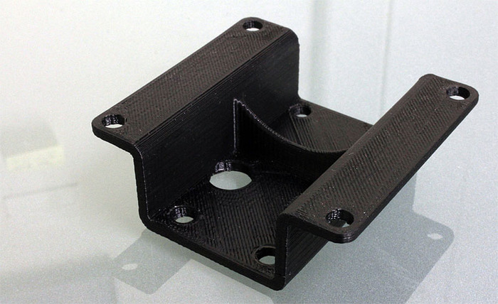 Extruder mounting bracket printed in black ABS