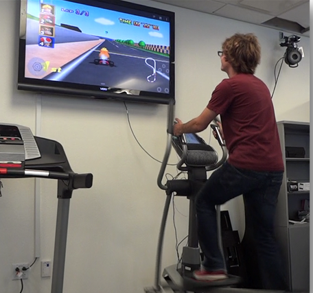 Jordan demonstrates an early version of the VERVE on standard exercise equipment at UCI. This unit showed the promise of a user-programmable device for mapping sensors to game inputs.