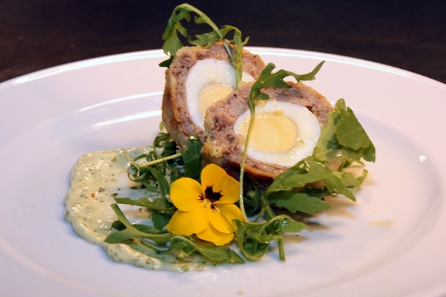 Paleo scotch egg with handmade herb mayonnaise