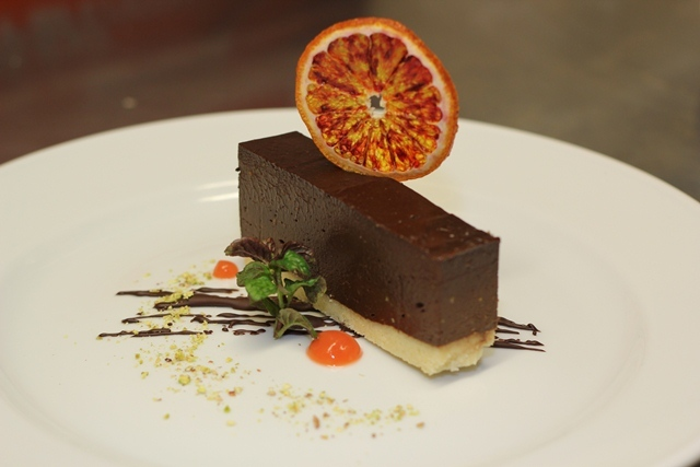 Chocolate orange mousse cake, blood orange gel and an orange crisp