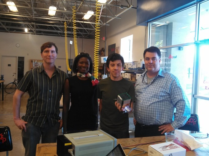 [Above: Tim, Mark's wife Johanna, Scott, and Mark at Tech Shop in San Jose after rebuilding SkyCube's balloon, 28 Sept 2013.]