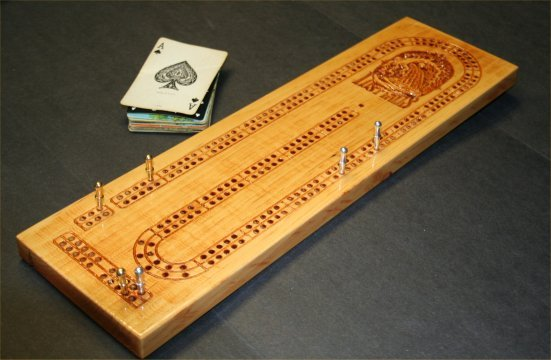 A handmade cribbage board emblazoned with our logo.