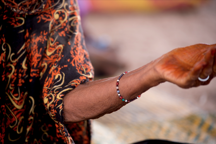 Agate bracelet worn by Malian woman in refugee camp - See incentives list for how you can get one! We will be paying the refugee women who make these bracelets out of your donation - so you will be supporting two causes!