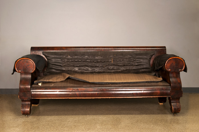 The courting couch as it appears now, awaiting treatment at The Conservation Center in Chicago