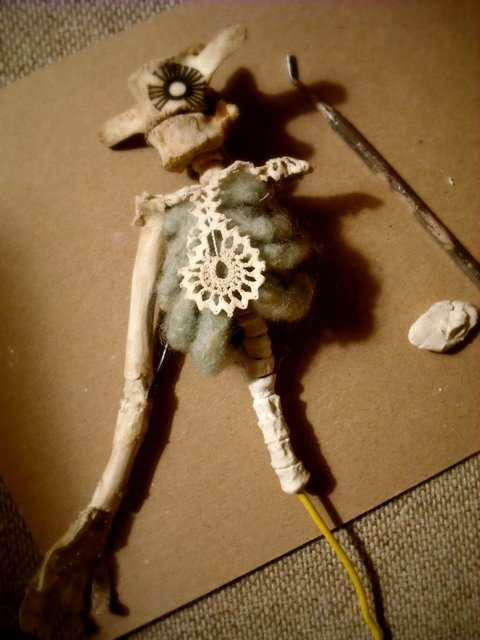 Building mini vertebra with the paperclay. the spine still flexes nicely