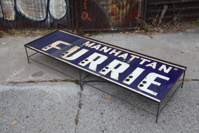 "MANHATTAN FURRIER metal and porcelain enamel storefront sign repurposed into a minimalist low table. 88"" x 30"" x 13"""