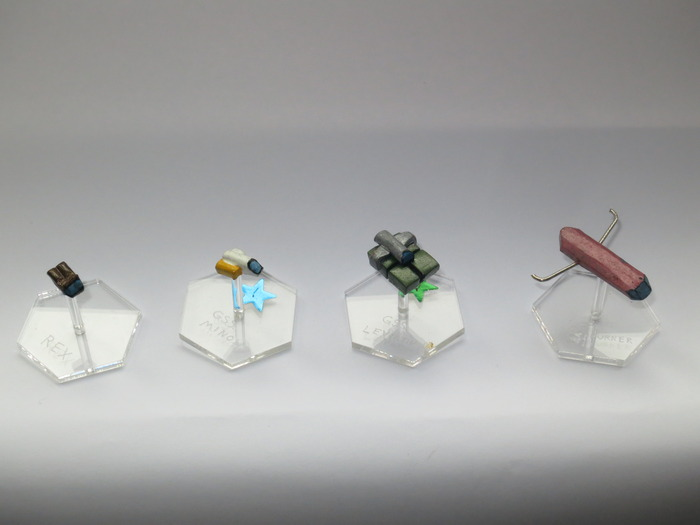 Original starships (Molded clay, baked, painted & mounted)
