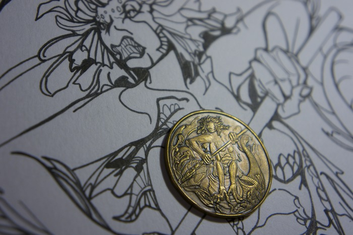 Water Naga coin, with original art.