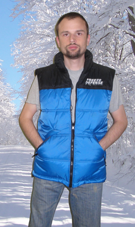 Zip-out vest, blue/black side.
