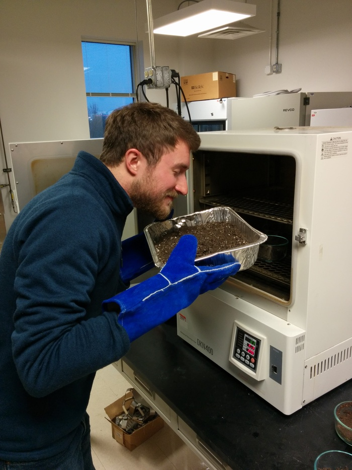 Michael pulls out a fresh batch of soil for another round of calibration.