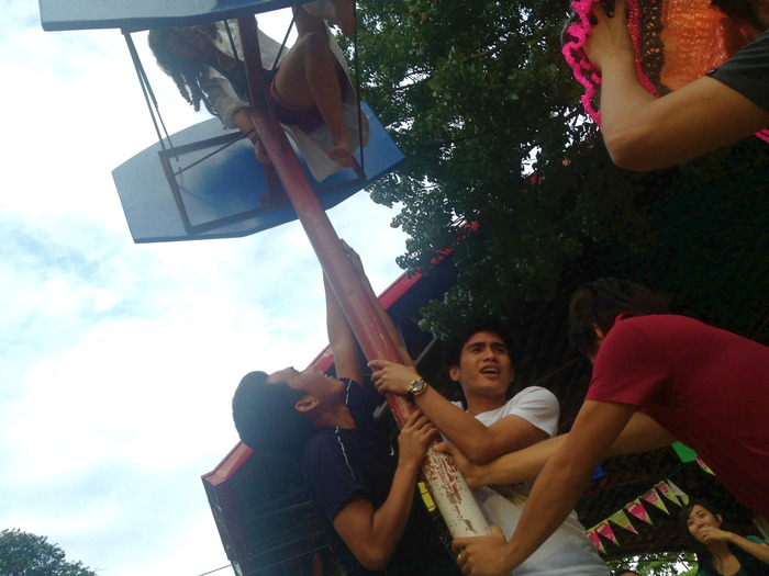 WMSU Students steady the pole as Maria climbs to the hoop, Zamboanga City, Philippines
