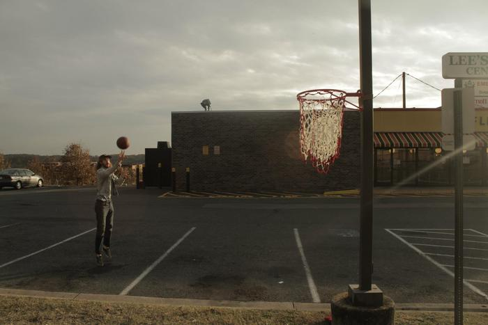 Anna Fox Rochinski's Net Work in an abandoned parking lot