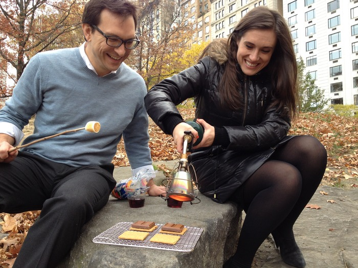 Our friends Phil and Rachel searing s'mores in Central Park.