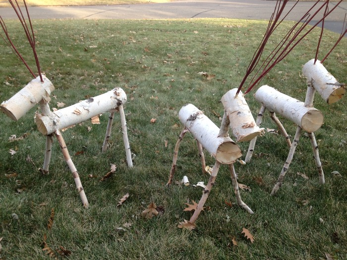 Deer lawn ornaments made from a fallen birch tree.