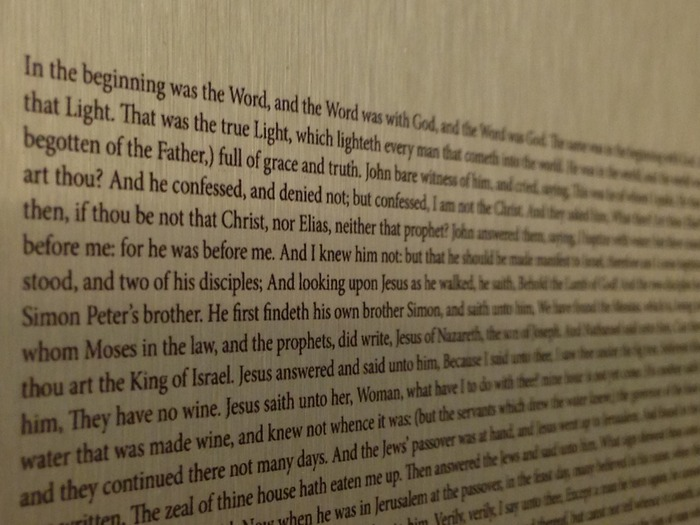 Close-up of the Gospel of John on Aluminum