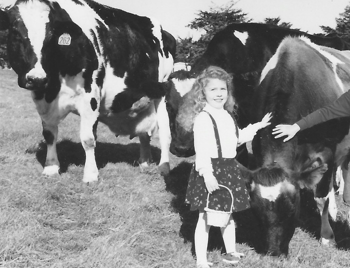 young Marissa with the family cows that had to be sold