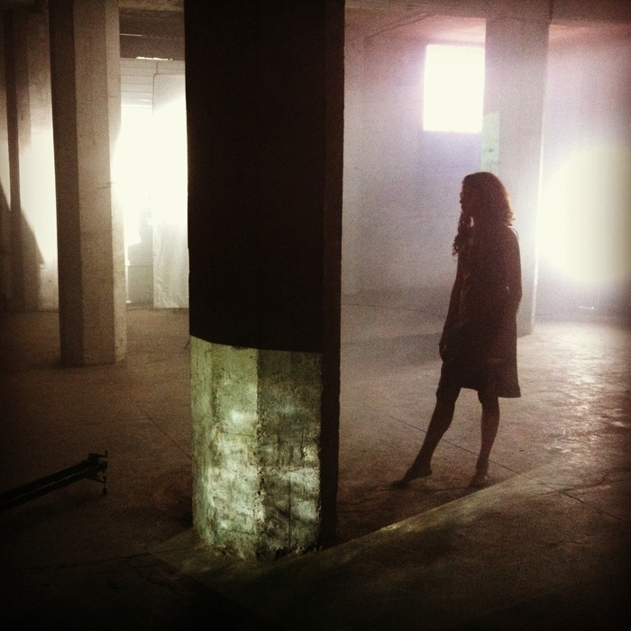 A dancer in the warehouse during shooting.