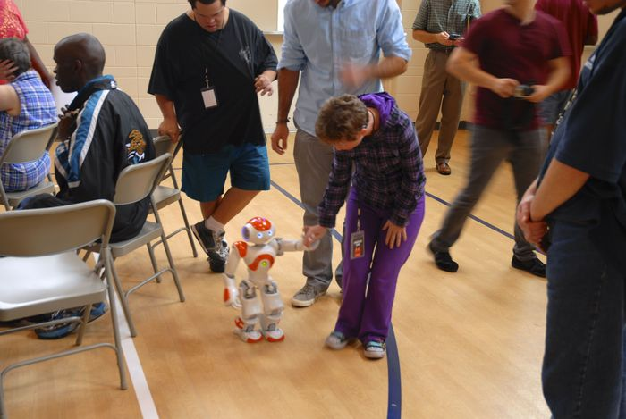 Here's NAO, an advanced humanoid interacting with our robotics club.  What if we could create a very low cost robot that was simple but which served as a friend and teaching tool?