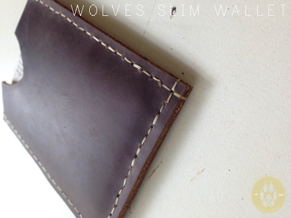 It can carry 10 card As well as a nice wad of cash. It fits comfortably in your pocket and is easy to use. Hand stitched