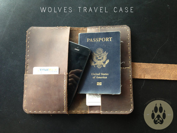The Wolves Travel Case is designed to hold a passport, credit cards, driving license etc. There is a reserved room for your boarding pass or your cell phone. Hand stitched.