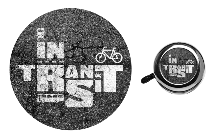 "The ""In Transit"" sticker and bike bell"