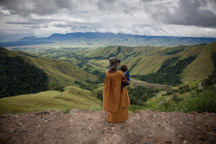 A woman looks down the valley from Kassam pass, Morobe province. The beautiful landscape of PNG's highlands belies the brutal reality of life in the region, where more than 90 per cent of women report suffering gender-based violence.
