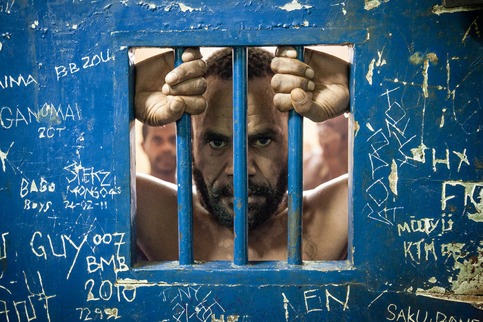 A PNG man is waiting for his court trial in his prison cell, having been accused of multiple rapes. Port Moresby, Boroko Police Station.