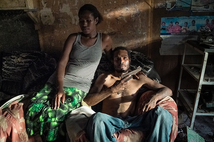 Omsy (right), an ex-member of the Kips Kaboni gang, with his wife Carol in their house. Omsy was a rapist and thief, but left the gang few years ago to become a bass guitarist.
