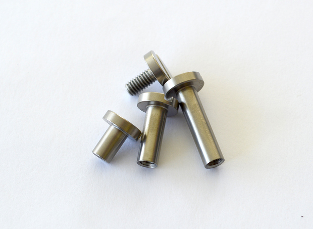 Totally CUSTOM-Made Titanium Screws And Posts Allow You To Carry From One To Seven Keys ...And Anything In Between!