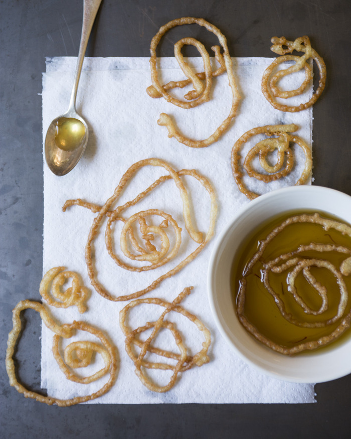 "Afghan ""Jalebi""--lemon saffron cookies--by Between Meals chef, Arezo. (Photograph by Victoria Wall Harris)"