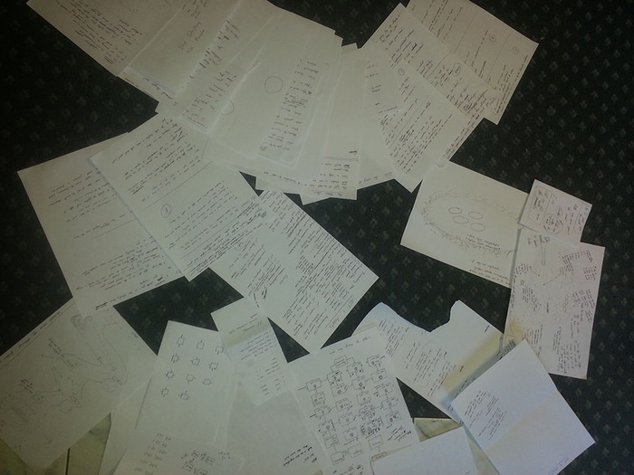 A pile of puzzle design documents from January's brainstorming session.
