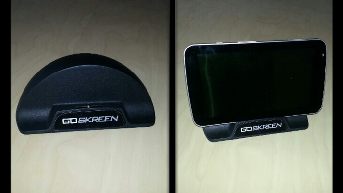 GoSkreen Stand:  Place your CarSkreen or another tablet in this stand, on your desk.  The stand directs audio from the back of the device to the front.