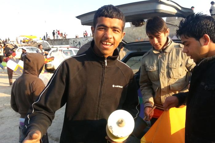 Noorullah getting ready to fly kites