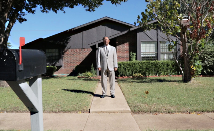 Kidane in front of his home in Dallas, Texas