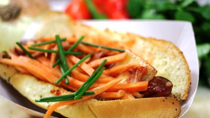 Seoul Dog - griddle seared hot dog with house made kim-chi, marinated carrots and shoyu mustard