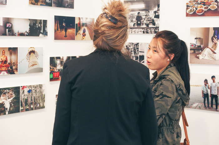 Tashi talks about her photographs with a new friend. (Photo by Jen LaVista)