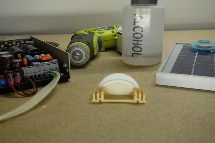 Early 3D printed parts to try different fits and aluminum with lens shapes.