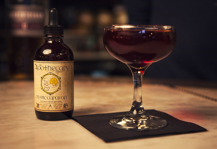 The Highwayman cocktail featuring our Mystic Caravan bitters.