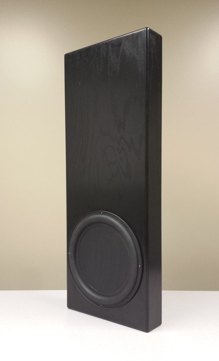 """TD-12 WX1 1000 Watt Subwoofer unit can be used in wall, under or behind furniture. Dimensions; 36"""" x 14"""" x """"3.5"""", Black, Included with the $1500 Pledge!"""