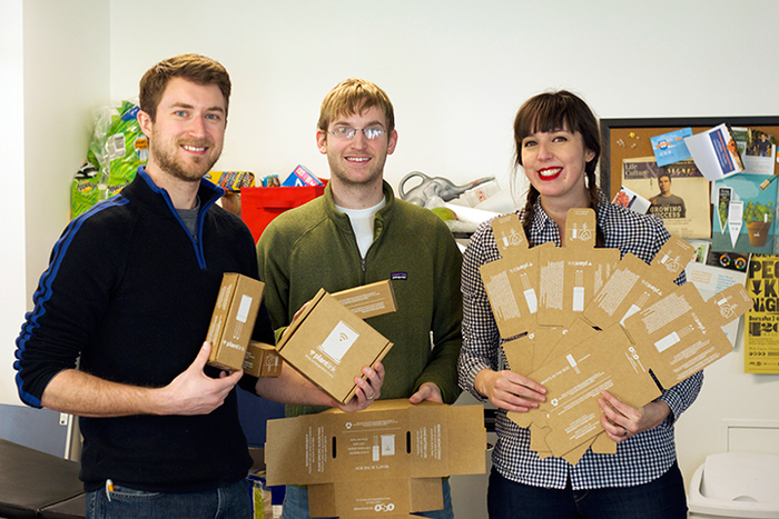 The boxes arrived!  We enlisted David (center) and Matthew (not pictured) to help us assemble boxes in exchange for cake.