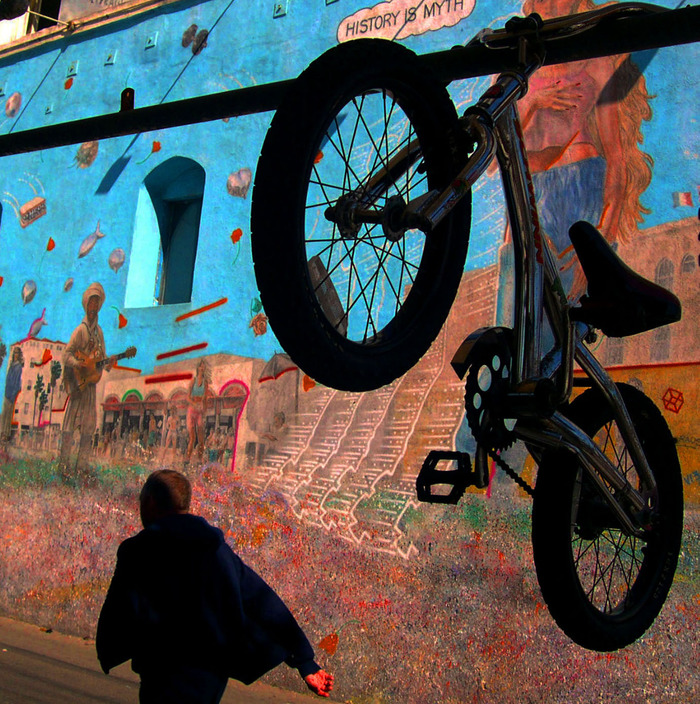 Bicycle in front of a mural on Venice Beach.