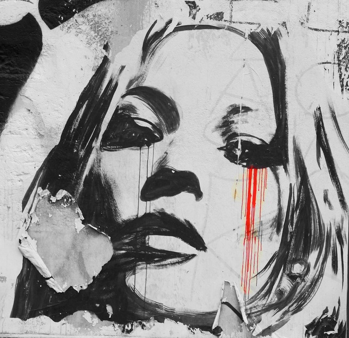 The paint peels ... the woman bleeds. What has she seen?